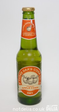 A bottle of Three Oaks Dry Crushed Apple Cider