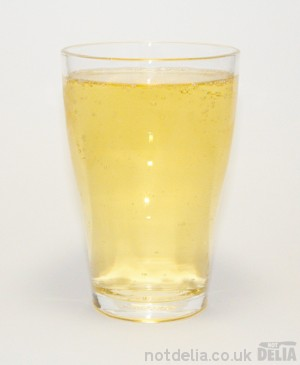 A glass of Three Oaks dry cider