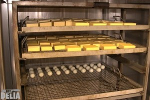 Racks of cheese and eggs in a smoker prior to smoking