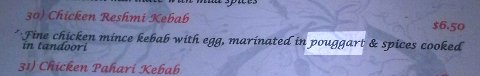 "Menu description of chicken reshmi kebab ""marinated in pouggart"""