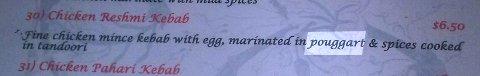 "Menu description of chicken reshmi kebab ""marinated in pouggart"""