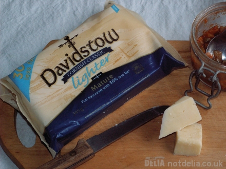Davidstow Cornish Classic Lighter Cheese on a board with crackers