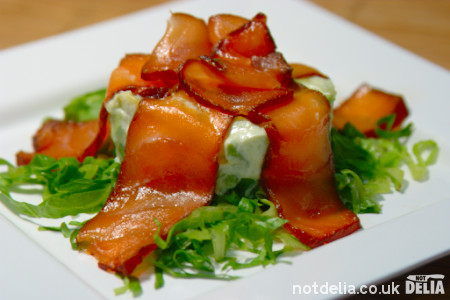 Slices of marinated salmon fillet on a mousse and salad base