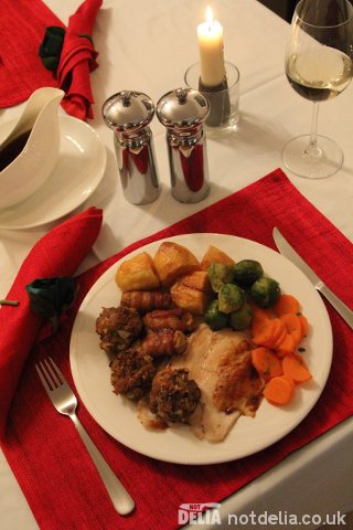 A delicious turkey dinner complete with stuffing balls, pigs in blankets, roast potatoes, sprouts and carrots