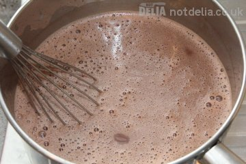Freshly-made hot chocolate being whisked