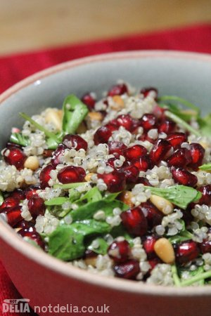 Pomegranate, quinoa and herb salad served in a celadon bowl