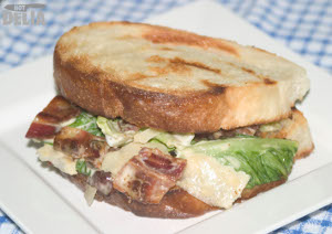 Caesar salad sandwich on fried bread