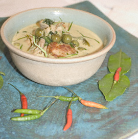 A bowl of Thai green curry with pork
