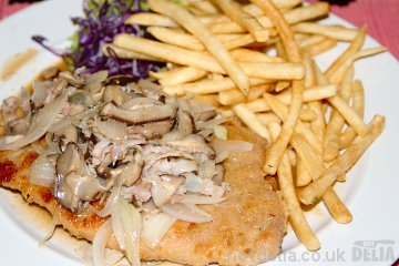 Jägerschnitzel (pork schnitzel with mushroom sauce) and shoestring fries
