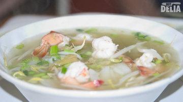 A bowl of prawn noodle soup