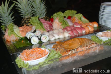 A display of assorted sushi on ice at a hotel buffet