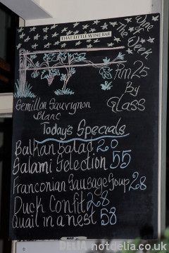 A blackboard with food and wine specials listed