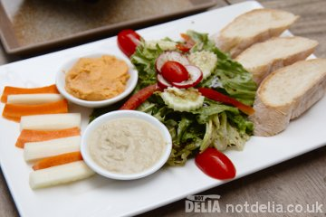 Roasted red pepper hummus and aubergine dip with salad and crudités