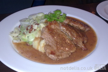 Pork with mash, sautéed cabbage and mustard gravy from Mulligan's, Pattaya