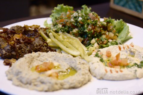 Moujadara, tabbouleh, hummus and babaghanoush on a plate