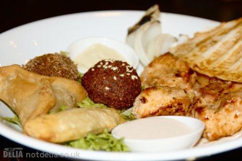 Kibbeh, falafel, sambousik, rikakat, shishtaouk and kelege on a plate