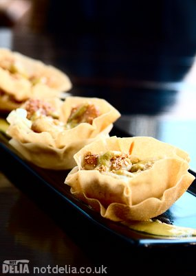 Scallops with spicy coconut sauce in pastry flowers